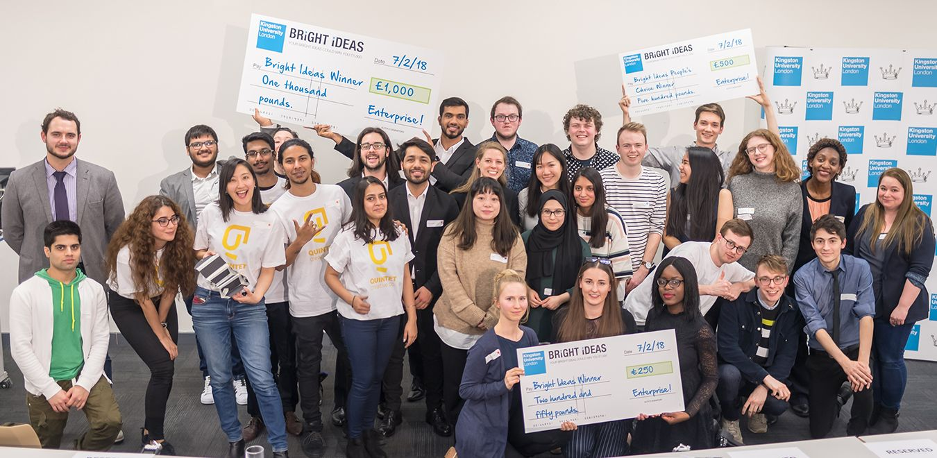prize winning students stand together with cheques