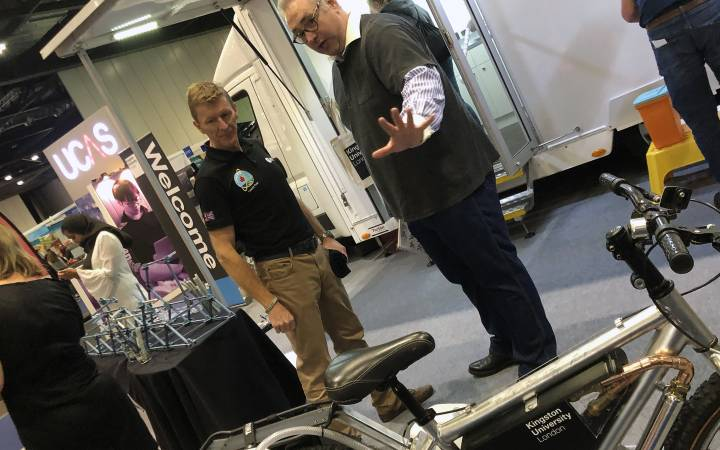 European Space Agency astronaut Tim Peake among visitors to Kingston University's lab in a lorry at New Scientist Live event