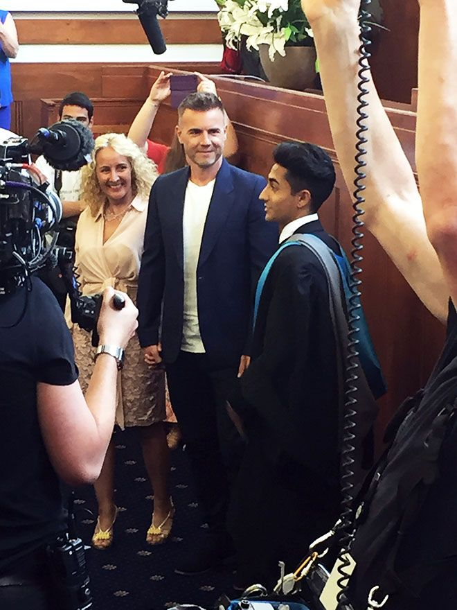 Photo of Kingston University graduate Anthony Sahota with his mum and Gary Barlow at his graduation surprise.