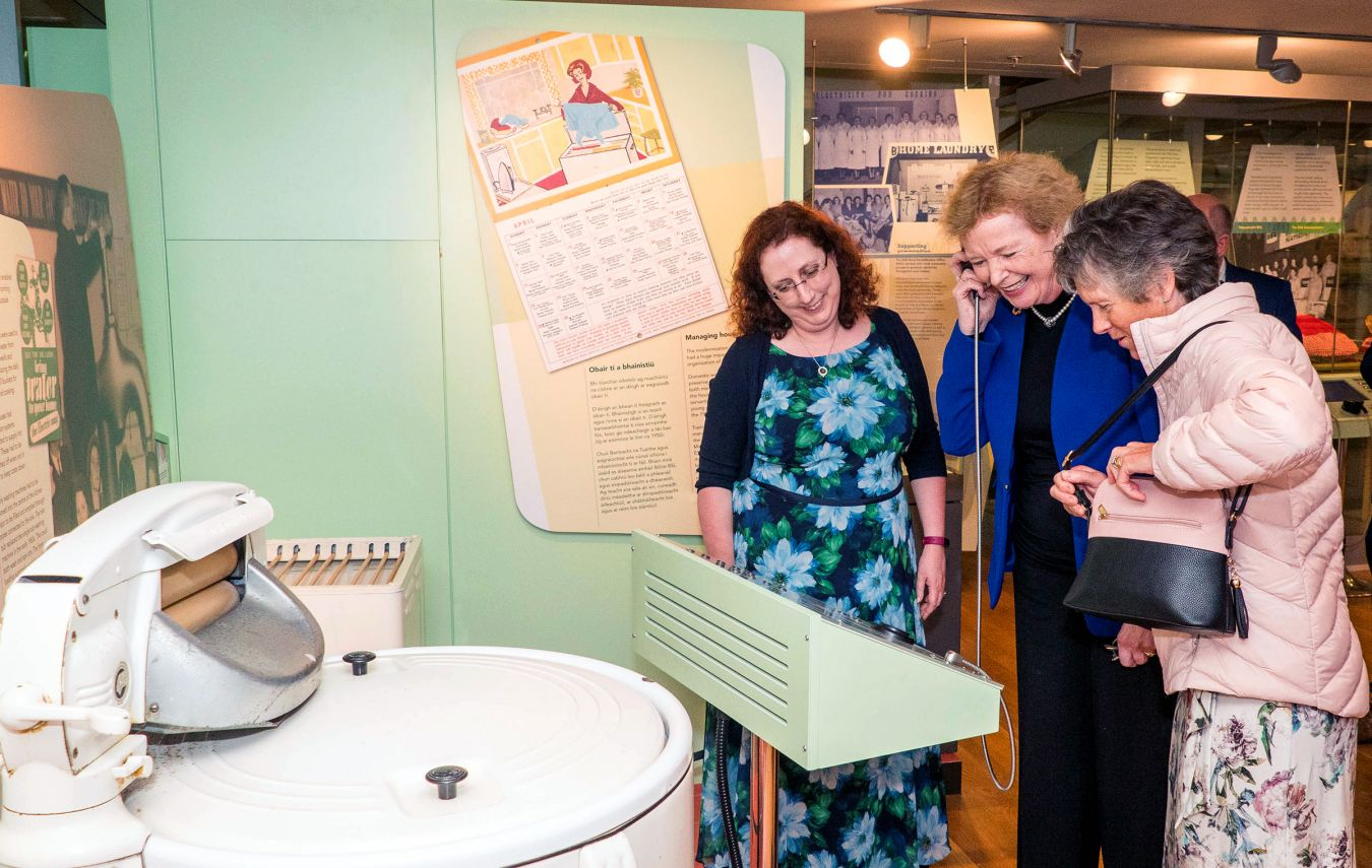 Dr Sorcha O\'Brien showing the oral history audio to Mary Robinson and Brigid O\'Brien, oral history participant.