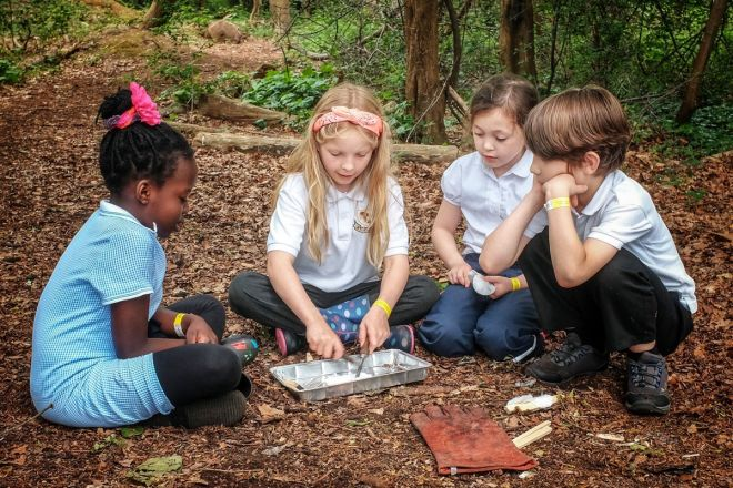 Creating campfires using sticks is one of the many activities the school pupils get to try.