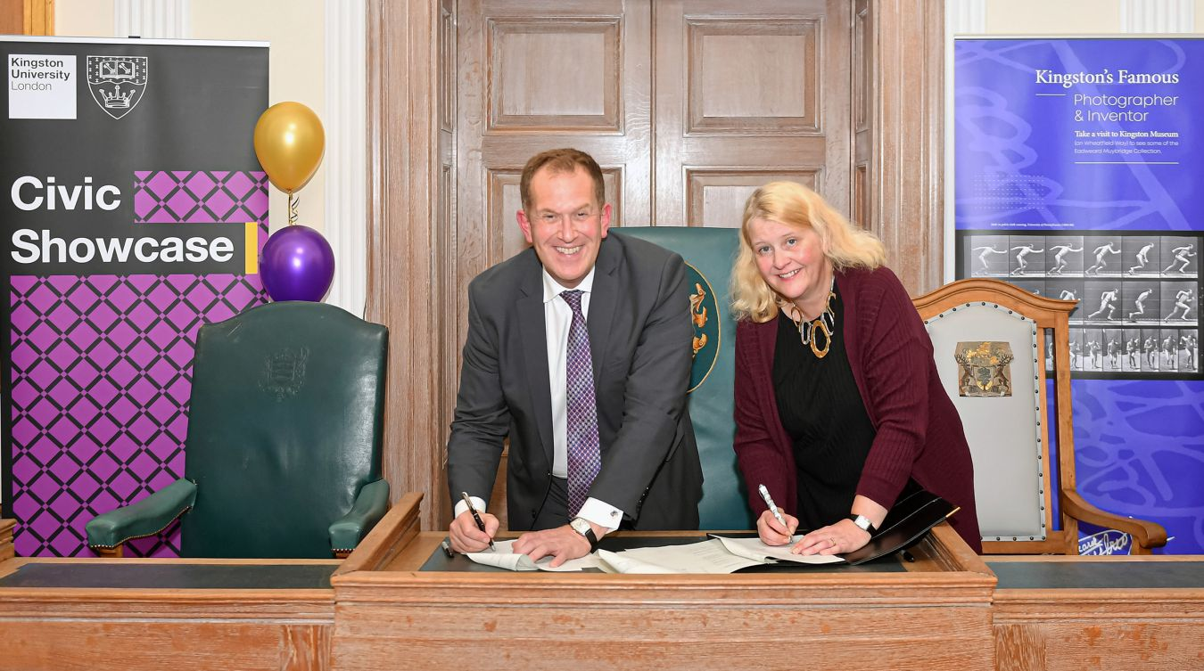 Council Leader Liz Green and Kingston University Vice-Chancellor Professor Steven Spier sign the memorandum of understanding at the University\'s civic showcase event at the town\'s Guildhall on Monday night.