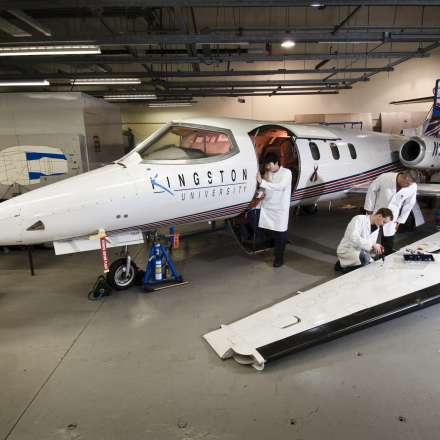 Students working on the universitys Learjet