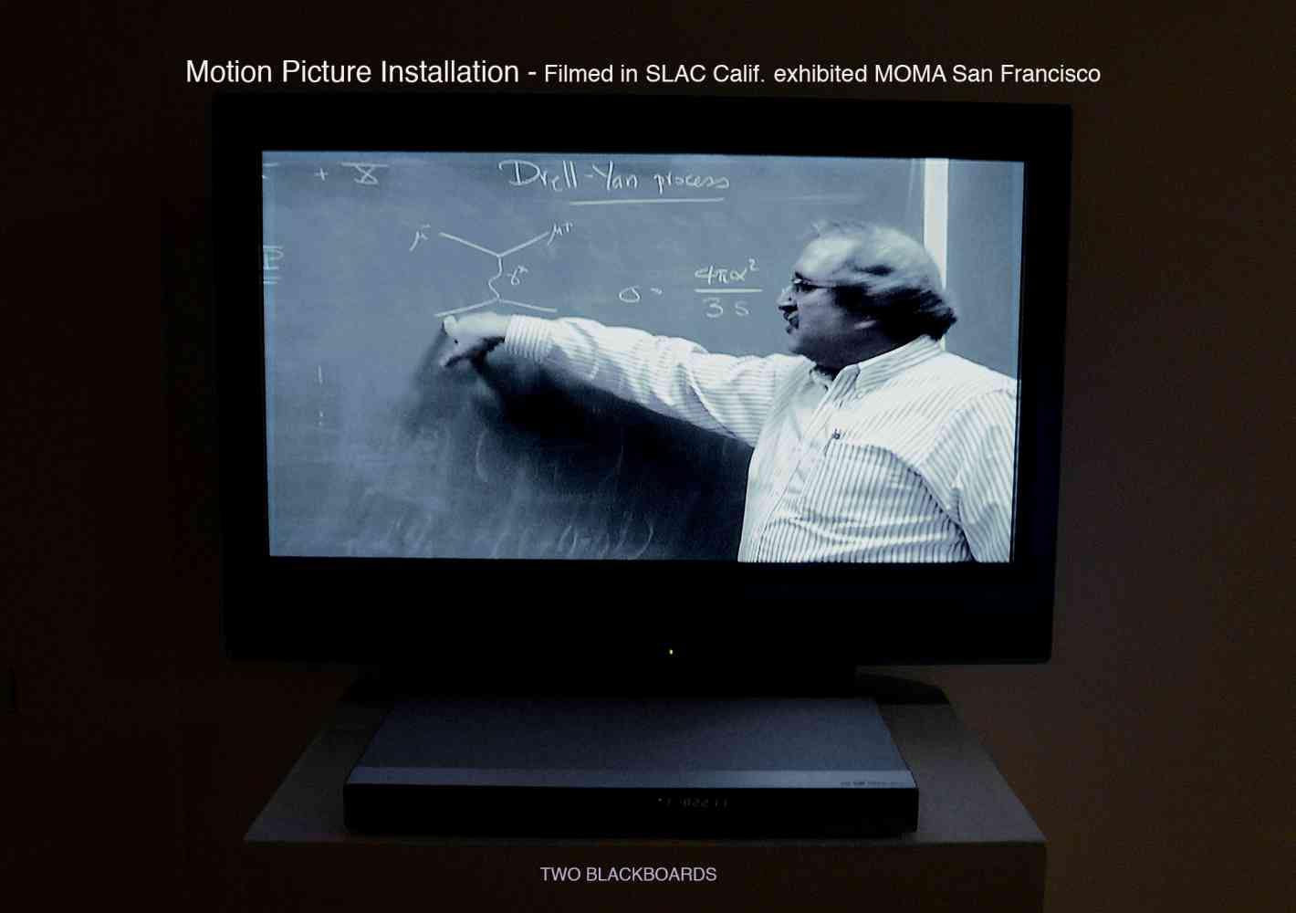 'Two Blackboards' 45min (Research) Motion Picture Installation as continuous projection loop. First shown MOMA San Francisco - In Collaboration with Michael Peskin, Head of the Theory Division, SLAC Stanford. What is Dark Energy? How many colours in a quark?