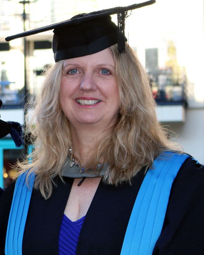 A photo of graduate Wendy French in her Kingston University graduation robes.
