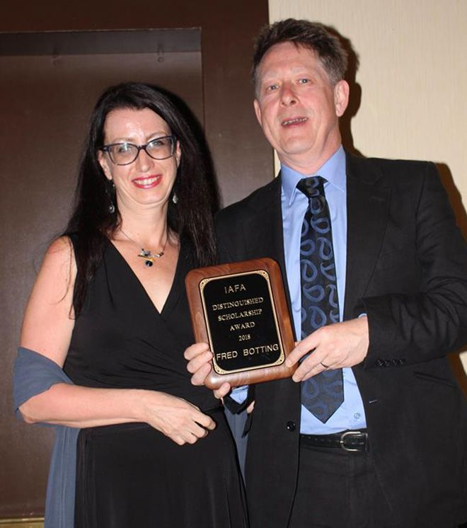 Professor Fred Botting accepts his Distinguised Scholar Award from IAFA president Professor Sherryl Vint