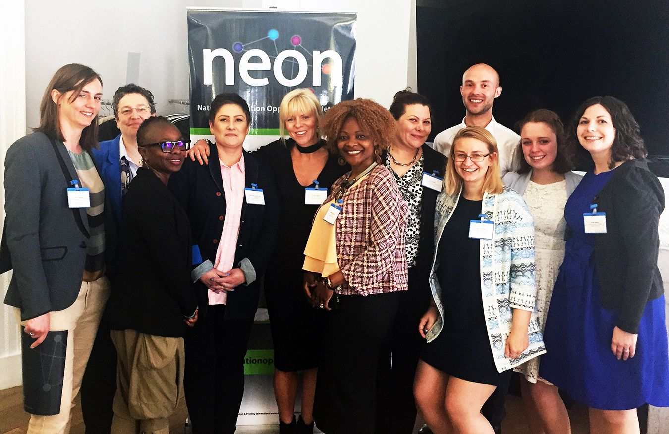 A photo of the NEON award winners receiving their trophy.