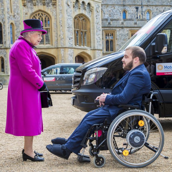 An image of the Queen and Edward Tonino and his new motability van at Windsor Castle