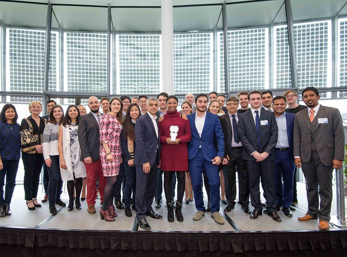 Mayor\\\'s Entrepreneur contestants stand in a group with Sadiq Khan and winner stands in the middle holding trophy
