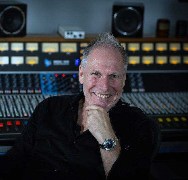 Walker's producer and collaborator Peter Walsh will be in attendance at the symposium.