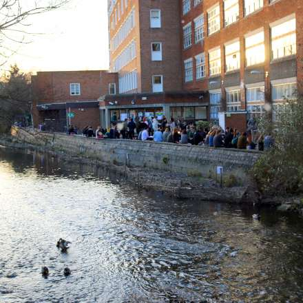 As the sun goes down by the side of the Hogsmill River