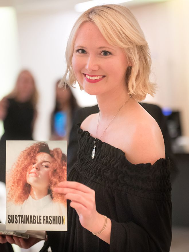 Jessica Joy Donnelly holds a copy of her magazine, Sustainble Fashion Journal.