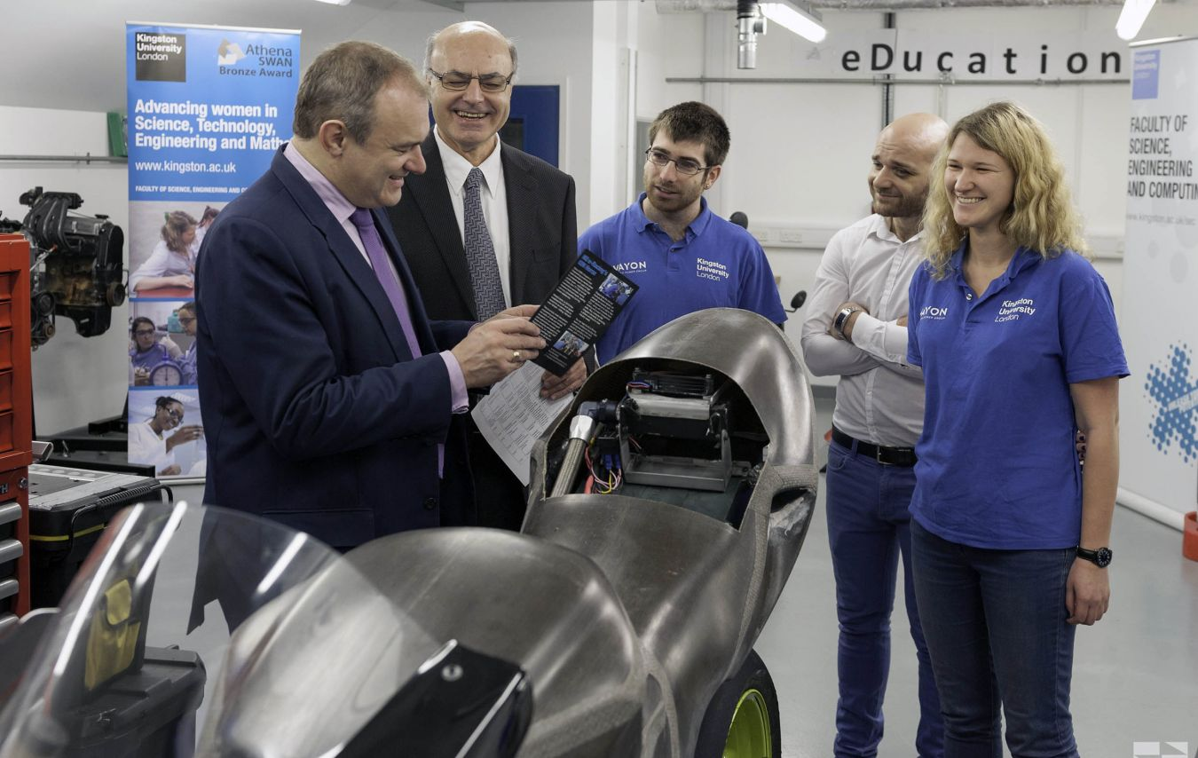 Ed Davey talks to Necip Sahinkaya, head of Mechanical and Automotive Engineering, and electric bike students