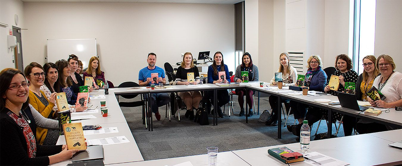 A photo of the Kingston University Big Read panel of staff and students sitting round a table.