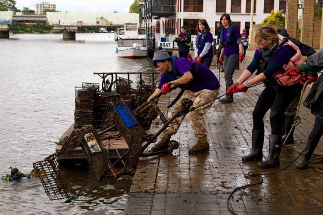 Volunteers help at the big river clean up in Kingston at the Thames