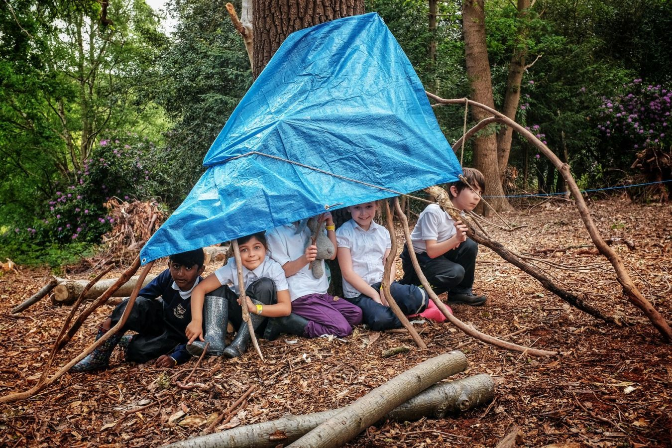 The pupils also learned how to create shelters using woodland material and tarpaulin.