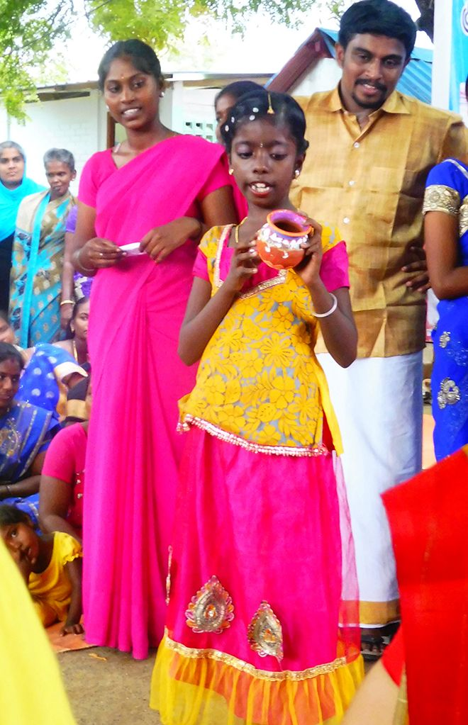 Picture of a young girl showing a put she\'s made in India.