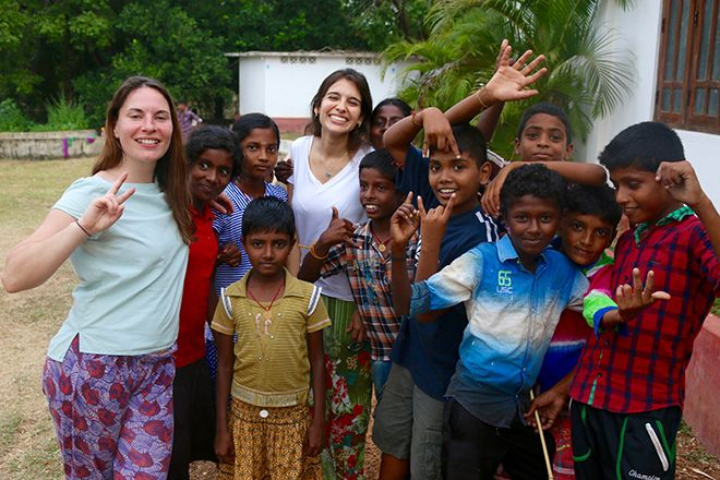 Kingston University students play games with Sri Lankan children during a three week volunteering expedition with Lebara Foundation