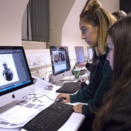 Student working in the journalism newsroom