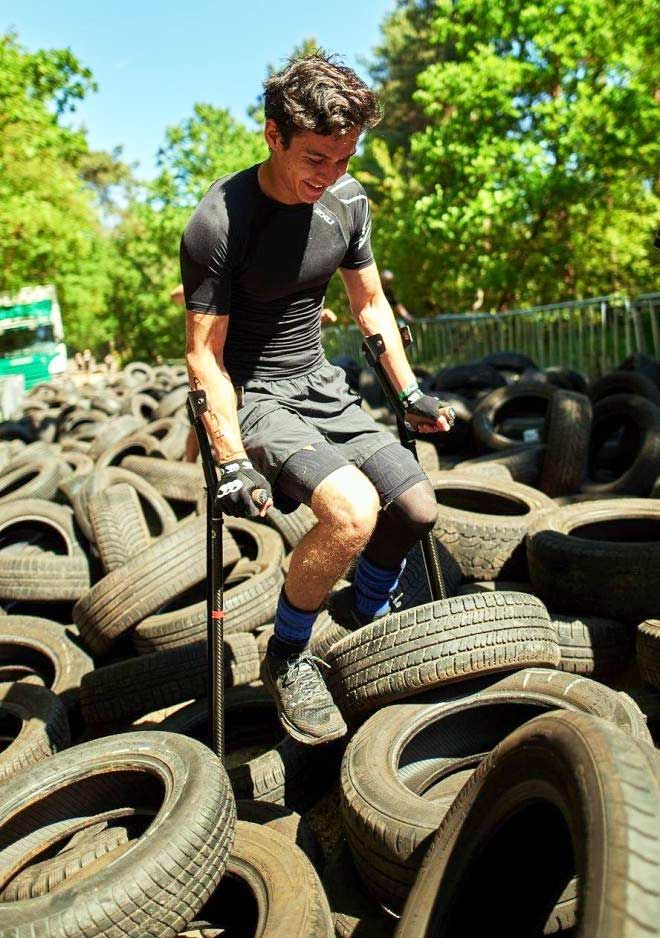 Picture of Oliver Lam-Watson on crutches taking part in an obstacle course
