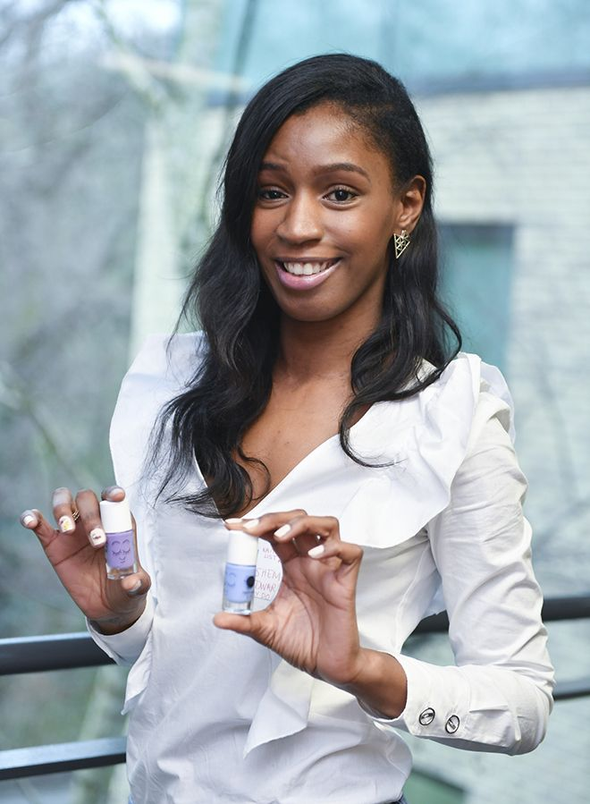 Kingston University student Ashema Edwards stands with bottles of nail paint as part her business Dinky Doodah
