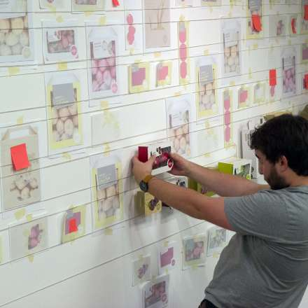 Student setting up a display of work in the Platform Gallery