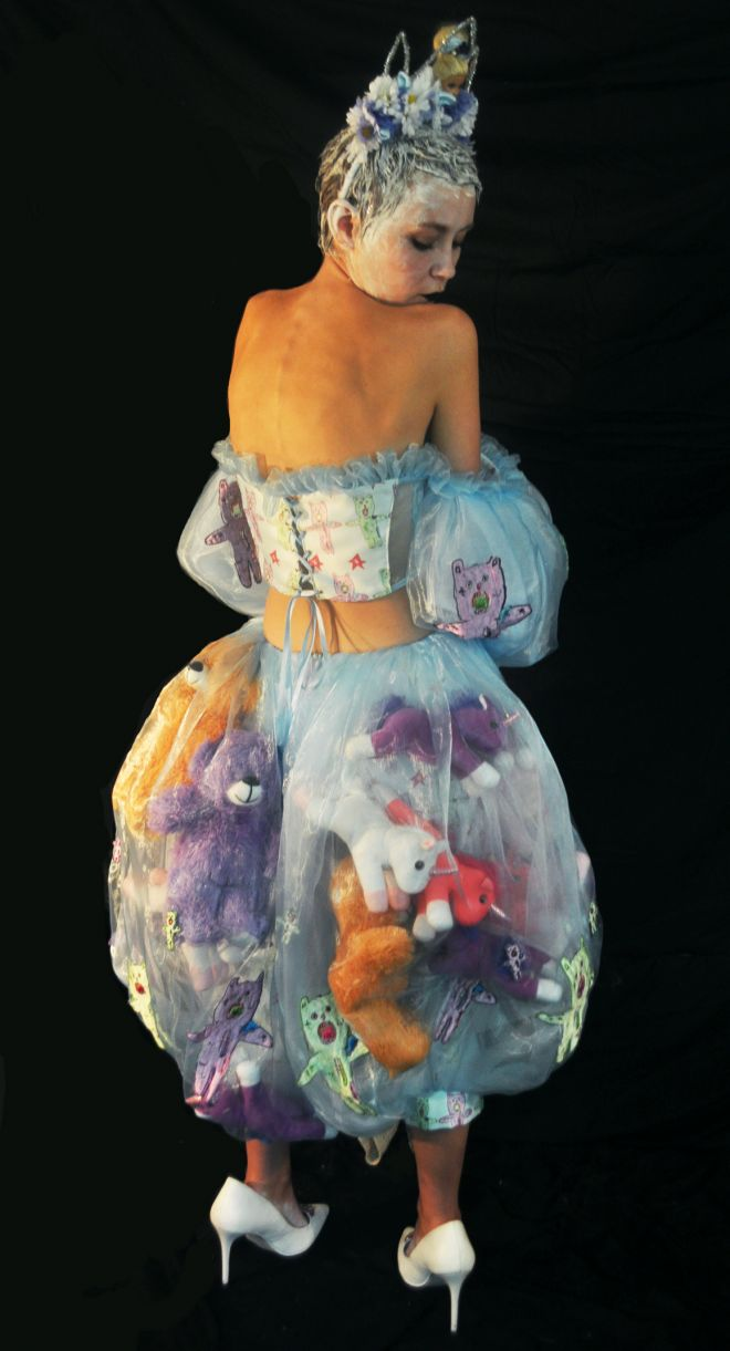 Fashion student Kate Clark models one of her garments, an organza netting skirt stuffed with her own teddy bears.
