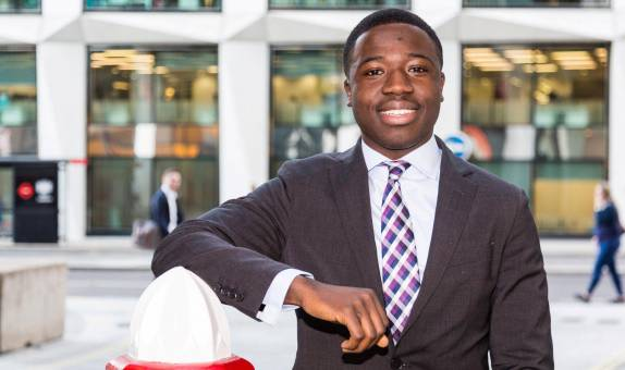 Driven Kingston University economics graduate overcomes tough upbringing to land top job in the City