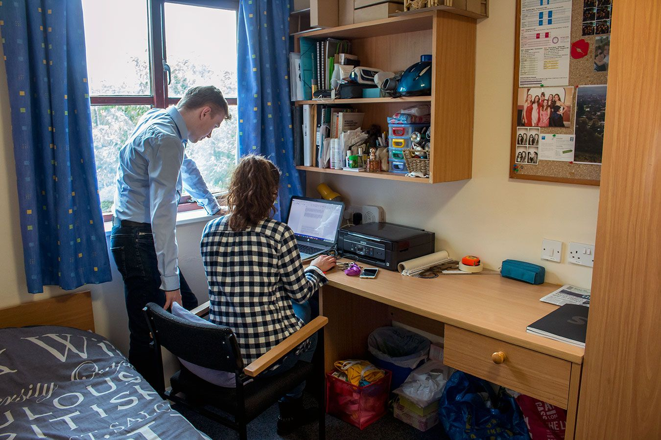 A photo of two students in a Kingston University Halls  bedroom.
