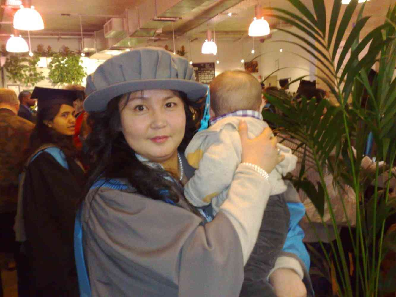 Dr Munkhchimeg (Moon) Ganbold and child - Graduation Day