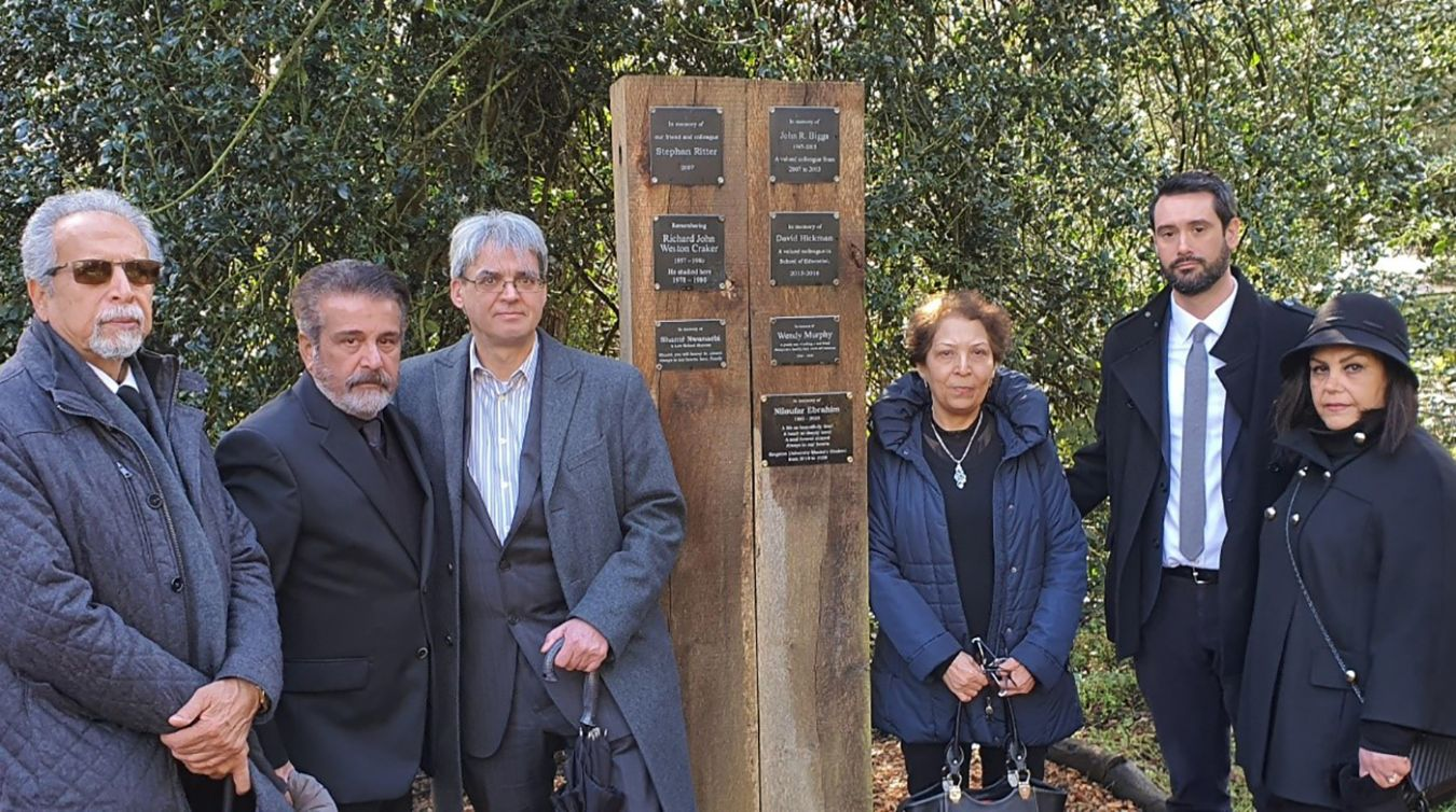 Ardeshir Tahmasebi (Saeed\'s father), Masood Ebrahim (Niloufar\'s father), Associate Dean of Education Dr Steve Bastow, Shahin Shakooea (Niloufar\'s mother), Faculty support manager Philip Lindsay and Sara Rastgou (Saeed\'s mother) by the plaque for Niloufar in the Kingston University memorial garden.