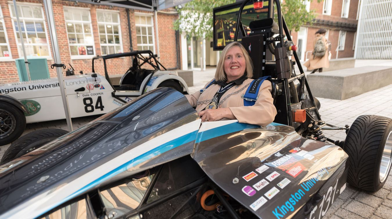 Mayor of Kingston Cllr Julie Pickering gets behind the wheel of the University\'s e-Racing car at the Civic Reception event.