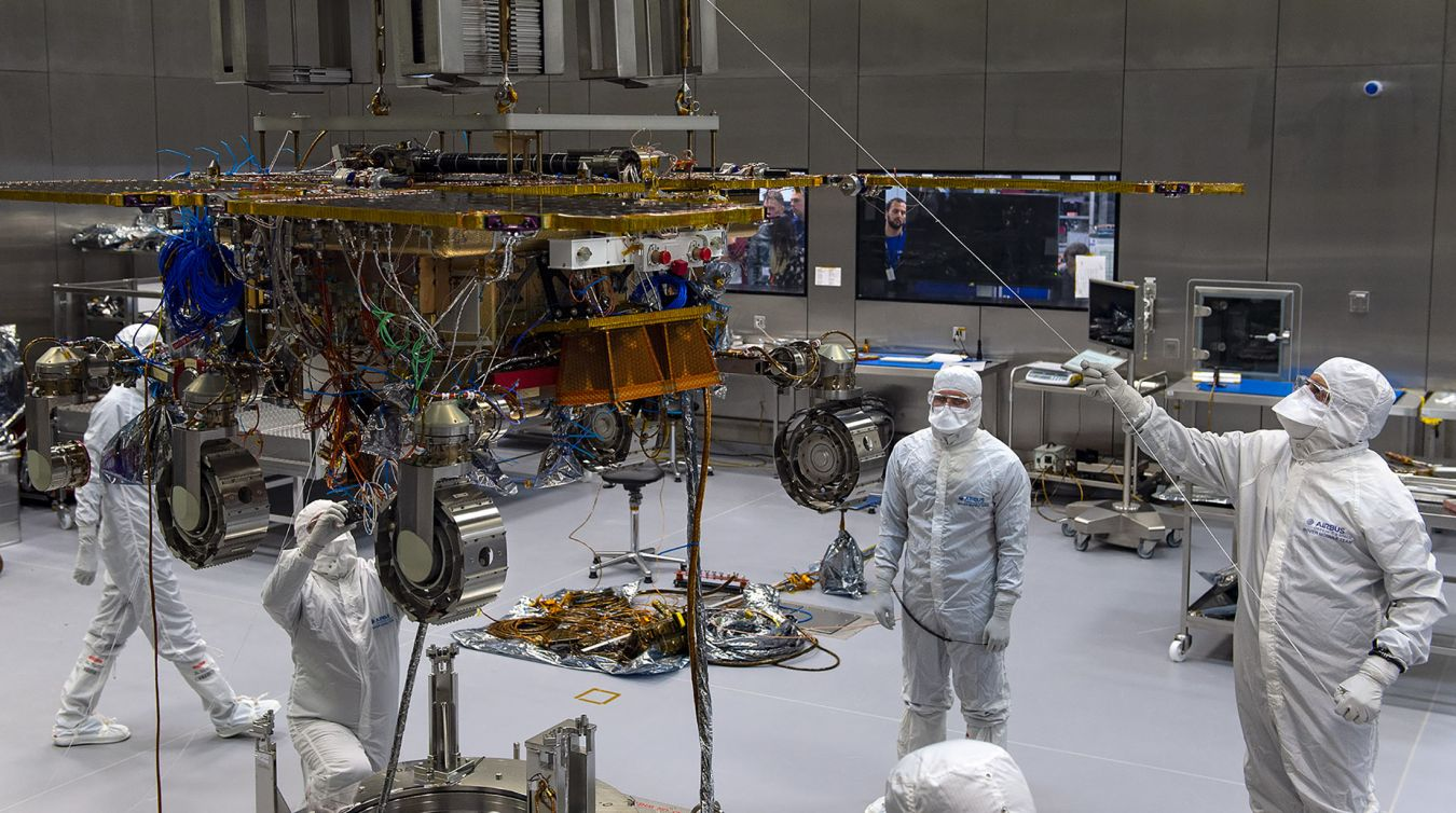 A team of skilled engineers and technicians led by Kingston University graduate Mahilal De Silva work on the Mars Rover build at the Airbus facility in Stevenage. Photo: Max Alexander/Airbus
