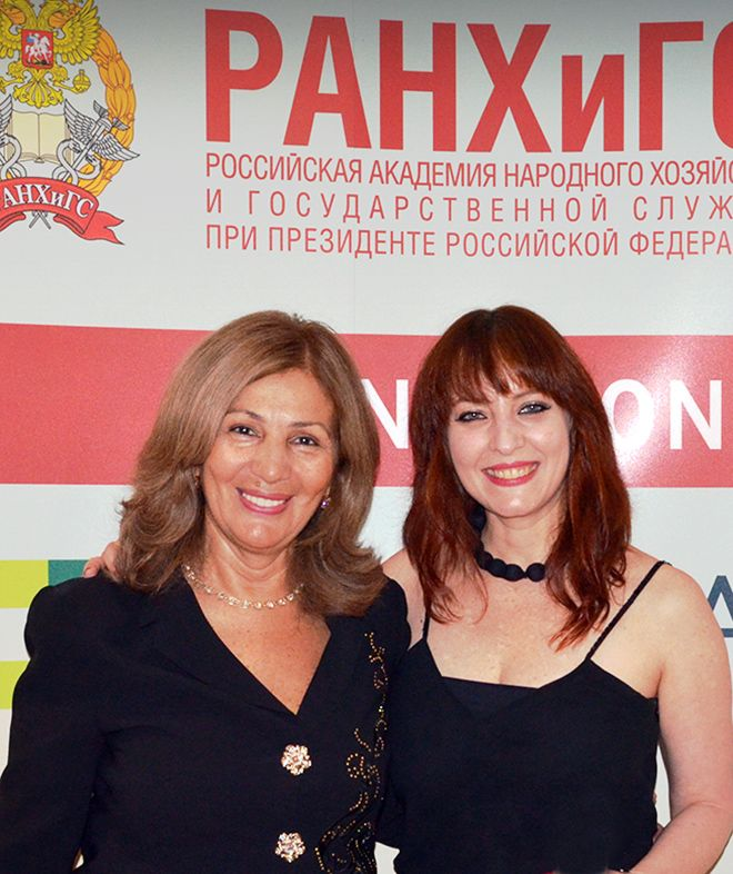A photo of two women at the Moscow MBA event.