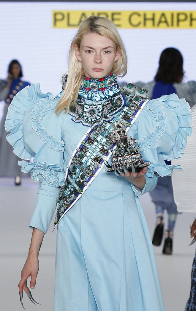 Plaire Chaiphet\'s royal cyborg crown, carried by the cyborg queen in her collection, won the Swarovski Sustainable Accessories Competition at Graduate Fashion Week.