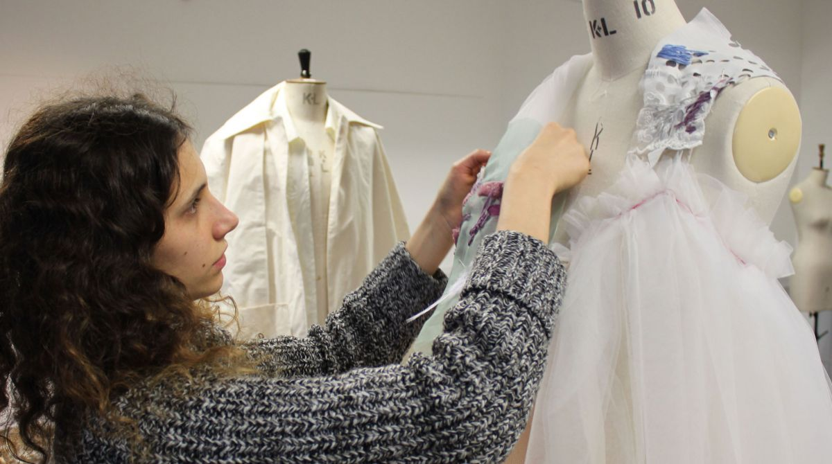 Visually impaired fashion student brings braille together with couture to create graduate collection