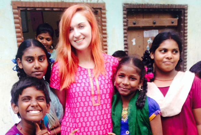 Kingston University journalism graduate Roxii Hoare-Smith surrounded by some of the children she met volunteering in India through the Lebara Foundation project.