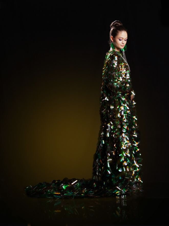 Aura Olarean has created eight dresses, each adorned with clear, green or brown plastic, which she hopes will highlight plastic use and create a more environment-friendly approach.