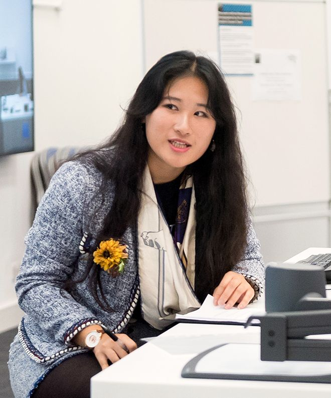 A photograph of business management student Sunny Ye at the hackathon event.