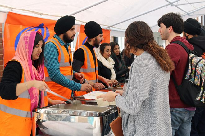 Sikh Society running a good stall at the Global Festival