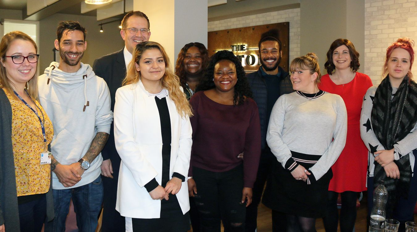 Vice-Chancellor Steven Spier with staff and students from the KU Cares scheme.
