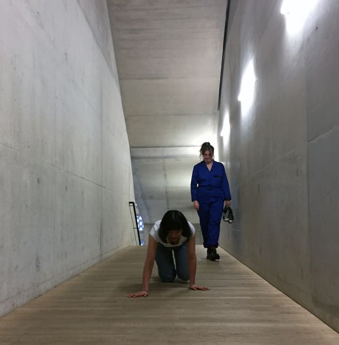 Kingston University fine art student \'Srijana Gurung performs a crawl as part of No Working Title