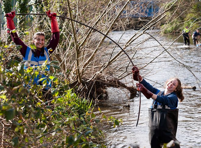 Volunteers help to clean up the Hogsmill River