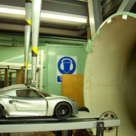 Testing aerodynamic design of a car scale model in wind tunnel