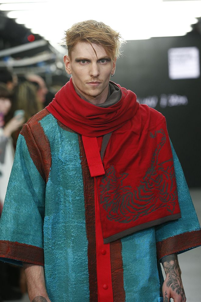 Designer Chi Wu recreated the drama of martial arts movies with a vibrant menswear range.