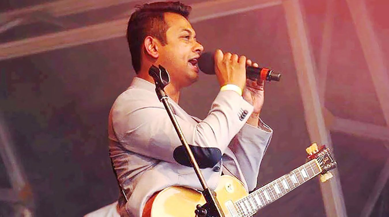 A photo of Clearing case-study student Ershad Alamgir singing at a festival
