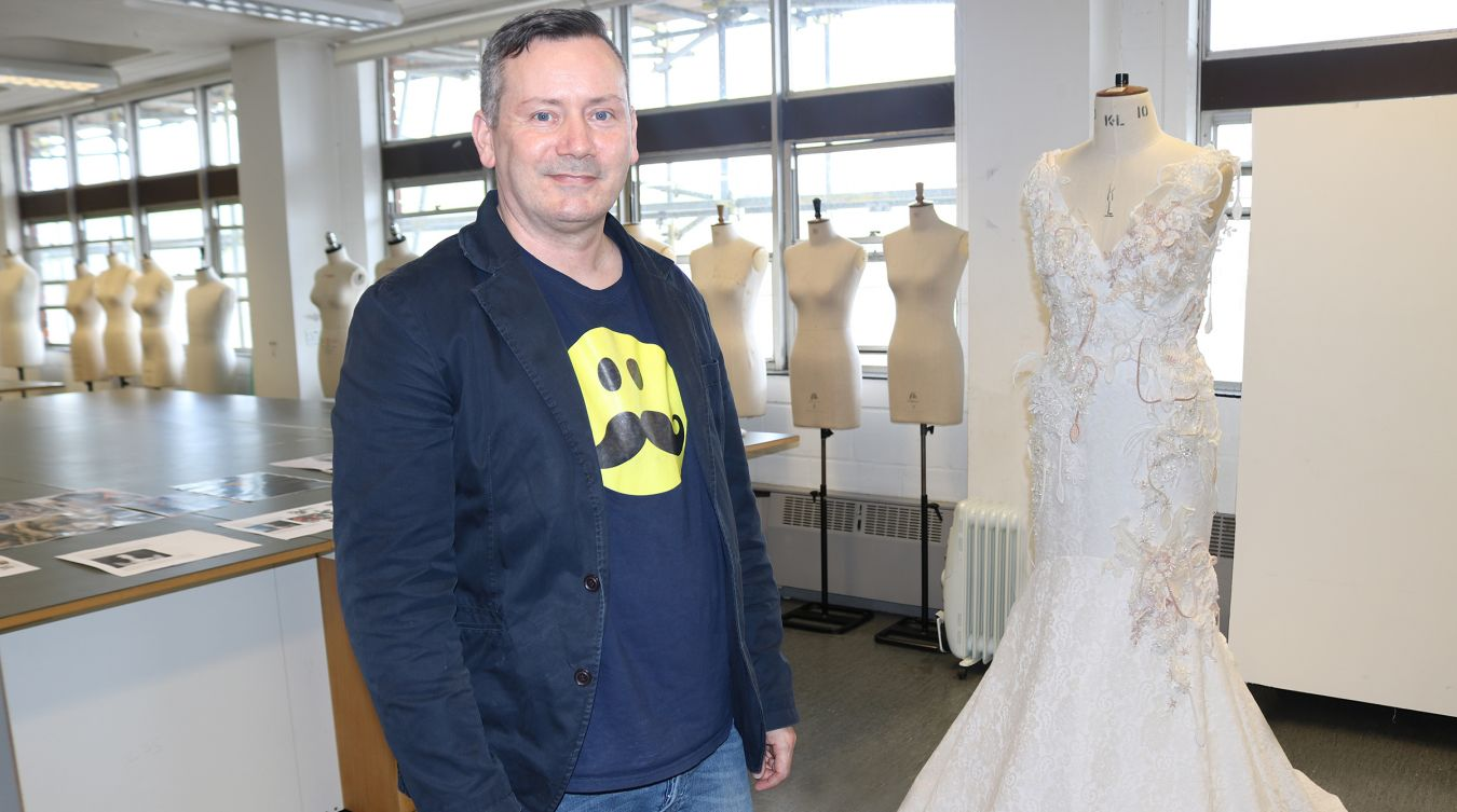 Fashion lecturer Paul Simonson with his design for an alternative wedding fress for Meghan Markle, inspired by the Cambodian temples of Angkor Wat.