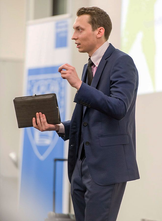 Photo of Sam Nozdrachov from Samuel L Notebooks speaking at the event.