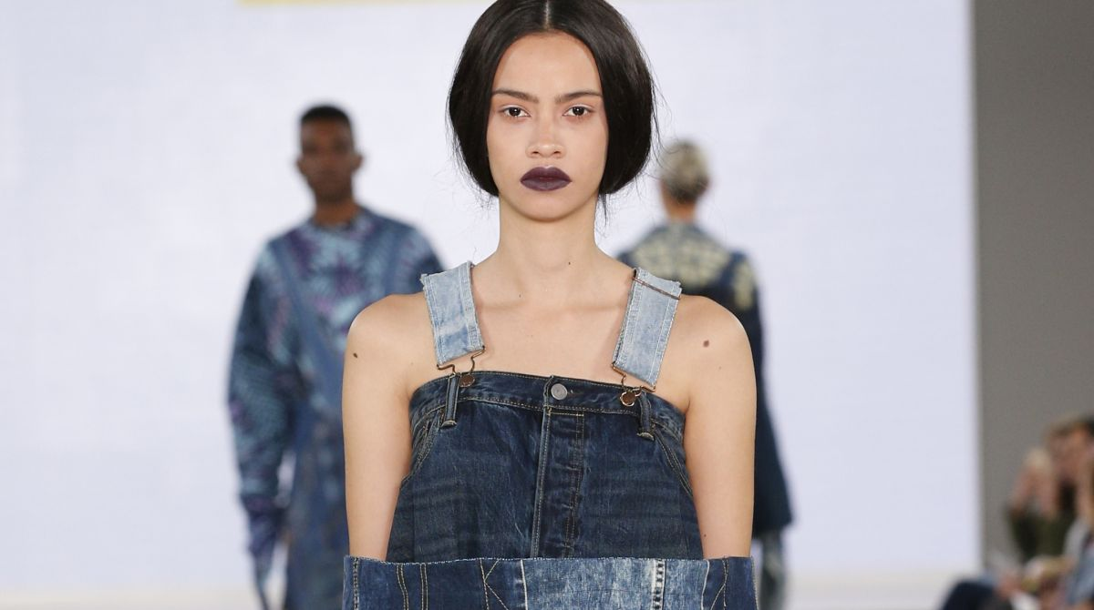 Kingston University designer's sustainable fusion of denim and African fabrics modelled at Graduate Fashion Week by industry icon Caryn Franklin