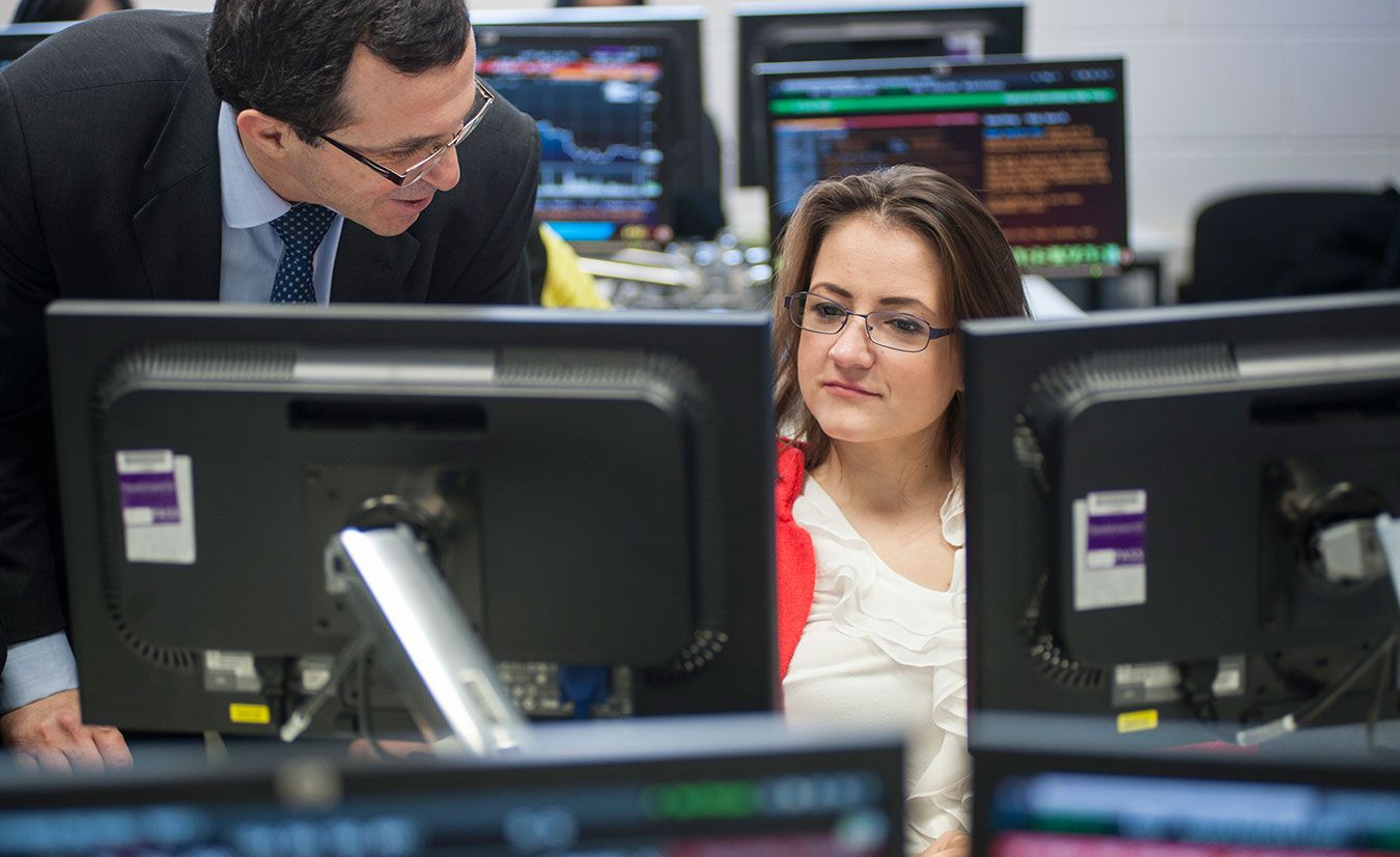 A picture of some postgraduate students in the Bloomberg room at Kingston Business School